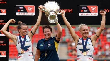 Chelsea Randall, Bec Goddard and Erin Phillip hold the cup aloft.