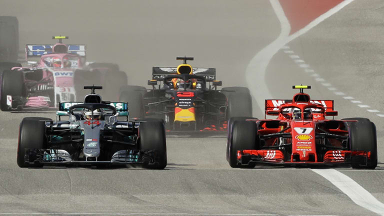 Drought-breaker: Ferrari's Kimi Raikkonen (right) passes Lewis Hamilton during the F1 Grand Prix in Texas.