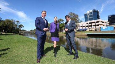 Former NSW premier Mike Baird (right) and then arts minister Troy Grant and MAAS director for the Powerhouse Museum Dolla Merrillees view the new Parramatta location in 2016.