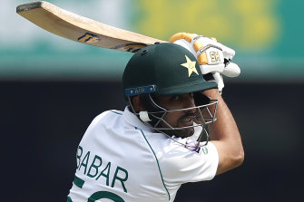 Babar Azam takes a swing and is caught off the bowling of Josh Hazlewood on day one at the Gabba.