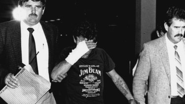Neville Towner is escorted into court in May 1989.