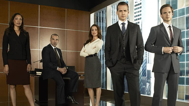 The main cast of Suits featuring Meghan Markle (third from right) and Gabriel Macht (fourth from right).