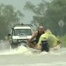 A metre of water sweeps through homes in Queensland floods