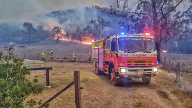 Firefighters from NSW Fire and Rescue battle a fire near Tenterfield.