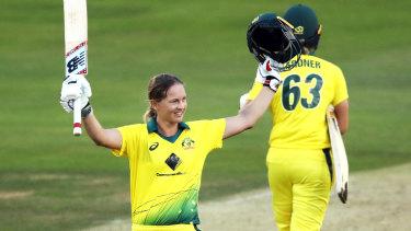 Meg Lanning celebrates her century against England.