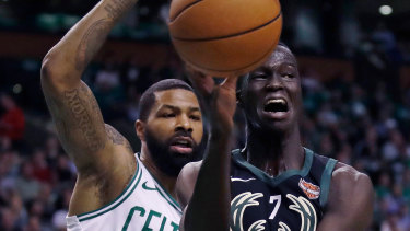 Locked down: Thon Maker is guarded by Marcus Morris.