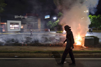 A Wendy's restaurant burns on Saturday, June 13 in Atlanta after protests blocked highway traffic.