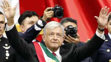 Mexico's new President Andres Manuel Lopez Obrador greets the crowd at the end of his inauguration ceremony at the National Congress in Mexico City, on Saturday.