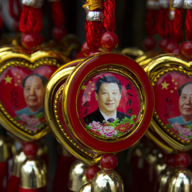 Souvenirs depicting Xi Jinping and the founder of the PRC, Mao Zedong.