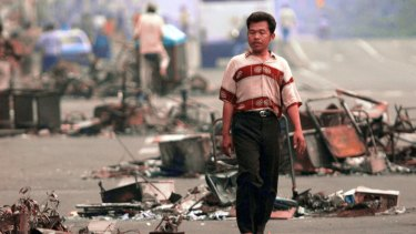 A Jakarta man in the debris-littered streets on May 16, 1998.