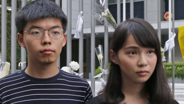 Pro-democracy activists Agnes Chow, right, and Joshua Wong meet media in June outside government offices in Hong Kong.