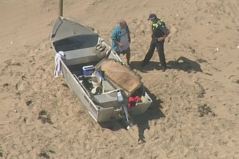 Rescue crews were called to an Anglesea beach after a small boat capsized just after 2pm on Saturday.