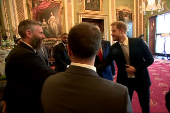 The Duke of Sussex (right) chats with Adam Hills about his beard before the draw.