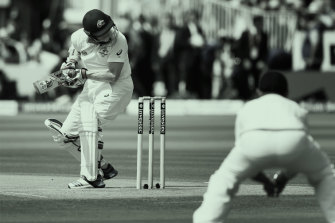 Australia's Chris Rogers takes a blow to the helmet during day two of the Second Ashes Test at Lord's in 2015.