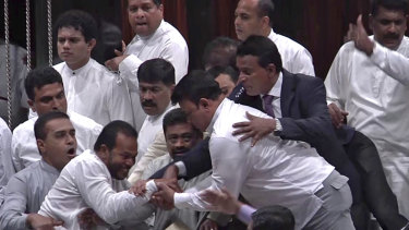 Sri Lankan MPs battle it out in Parliament.