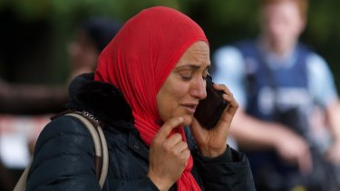 A worshipper emerges from the Deans Ave mosque in Christchurch, hours after a shooter opened fire.