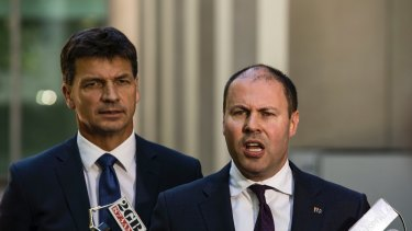 "Energy Minister Angus Taylor (left) and Treasurer Josh Frydenberg have rebuffed suggestions the ""big stick"" energy package will lead to a decline in investment in the sector."