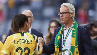 Outgoing FFA chief executive David Gallop greets Matildas player Emma Checker at Bankwest Stadium on Saturday.