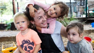 Childcare worker Lucy Gosling with children in her care. Workers in the sector lost a wage case in February this year.
