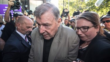 Cardinal George Pell arrives at court.