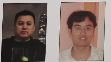A poster displayed during a news conference at the Department of Justice in Washington shows two Chinese citizens suspected of being with the group APT 10 carrying out an extensive hacking campaign to steal data from US companies.