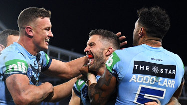 Big Ted: James Tedesco and the Blues celebrate a stunning victory.
