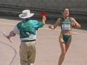 Lamberto Vacchi shows Jane Saville a red card at the Sydney Olympics.