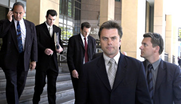 Then-Senior Sergeant Stuart Bateson leads members of the Purana taskforce away from Melbourne Magistrates Court in 2003.