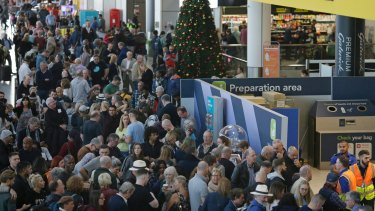 People wait near the departures gate at Gatwick airport on Thursday.