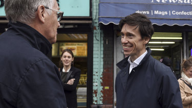 Rory Stewart, right, a candidate for prime minister, campaigns in Wigan, England.
