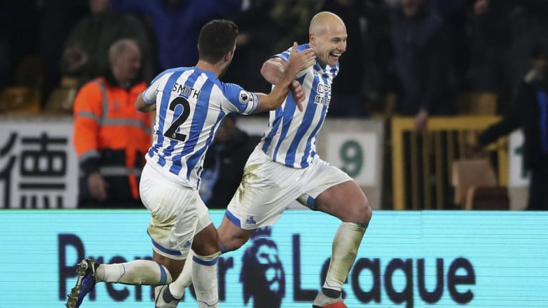 Huddersfield's Aaron Mooy celebrates scoring his second goal against Wolves.