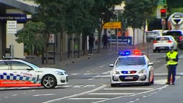Police establish a crime scene where the woman was fatally hit.