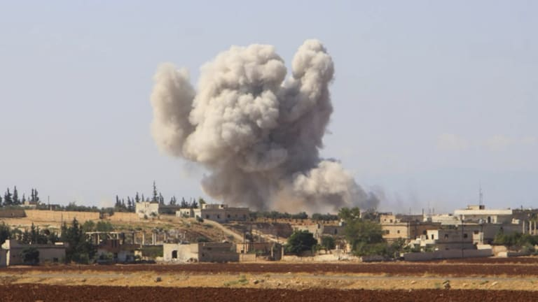 Smoke rises after a Syrian government airstrike, in Hobeit village, near Idlib, Syria.