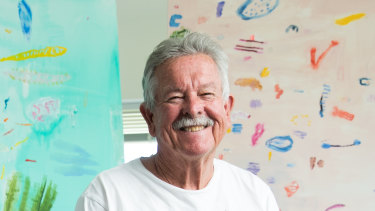 Ken Done in his Sydney studio with recent paintings Dive 4,2019 (left), and Big December Beach, 2018.