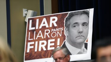 A poster of Michael Cohen at his congressional hearing this week.