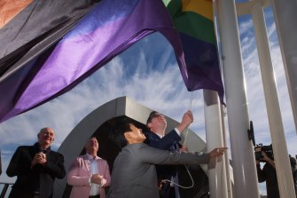 Premier Daniel Andrews and Hang Vo, chair of the Victorian pride centre, raise the flag at the Victorian Pride Centre in St Kilda.