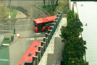 A SkyBus arrives at Crown Promenade on Thursday. The buses carried returned overseas travellers beginning their mandatory 14-day hotel stay.