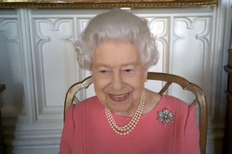 """Queen Elizabeth on a video call with health officials, saying that when she was vaccinated """"it didn't hurt at all""""."""