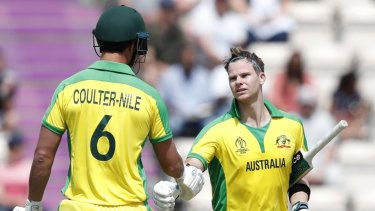 Nathan Coulter-Nile congratulates the former skipper on reaching triple figures.