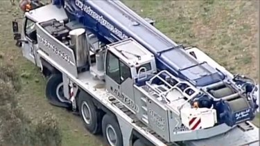 Horrific smash': Man dies after being hit by crane on freeway