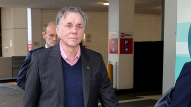 Nobel laureate Barry Marshall leaves the Perth Magistrates Court.