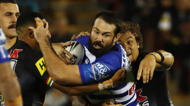 Working Dog: Canterbury prop Aaron Woods takes a hit-up on Friday night.