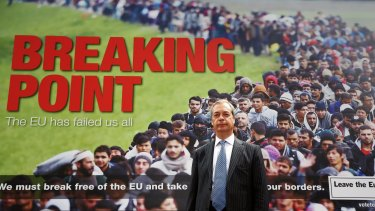 "Leader of the UK Independence Party Nigel Farage with the infamous ""Breaking Point"" poster during the Brexit campaign."