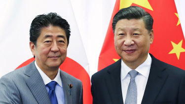 Chinese President Xi Jinping, right, with Japanese Prime Minister Shinzo Abe, representing two of Australia's most important trading partners.