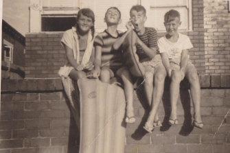 Children clowning outside 33 Eurimbla Avenue, c1960.