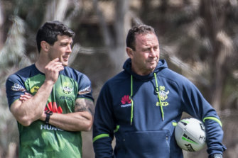 Odd couple: Michael Ennis with Ricky Stuart at a Canberra training session.