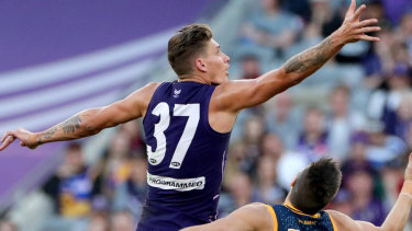 Rory Lobb and Stefan Martin  contest during the Round 10 AFL match between the Fremantle Dockers and the Brisbane Lions at Optus Stadium.
