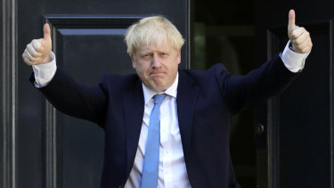 Newly-elected leader Boris Johnson arrives at Conservative party HQ in London.
