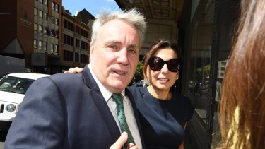 Michael Cranston and his wife, Gloria, after he was found not guilty of misusing his position to help his son.