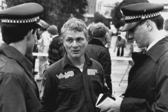 Lucky escape … Mr Peter Horeau speaks to police after the incident.